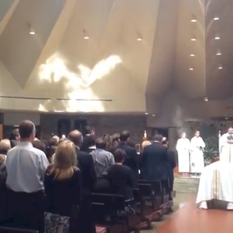 Angel appears at funeral watch closely as it fades away videographers