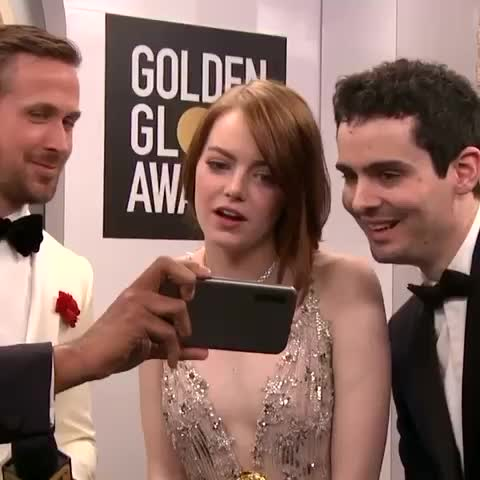 Emma Stone's reaction after watching the video of Andrew Garfield and Ryan Reynolds' kiss 😂😂😂 #goldenglobes #emmastone #ryangosling
