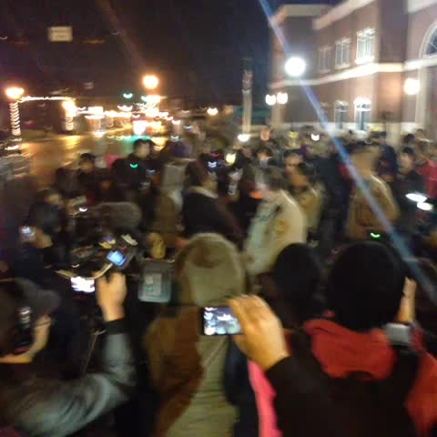 Protestors have moved across the street, surrounded police at Ferguson Police Dept: - Micah Grimess post on Vine