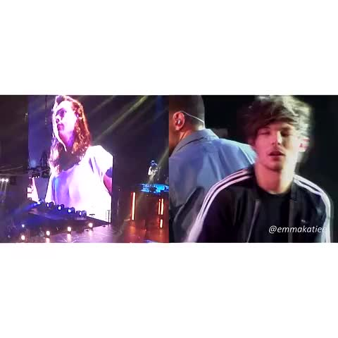 Louis watching Harry on the big screen :)