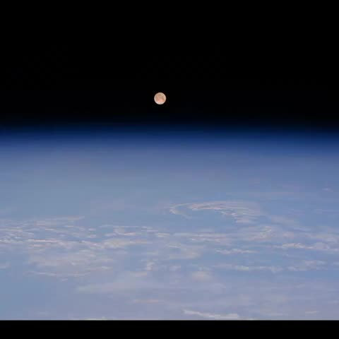 Vine by Terry W. Virts - Full #moon setting over Hokkaido and Vladivostok.