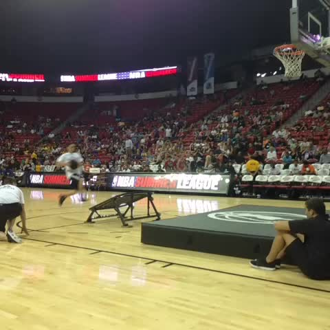 NBAs post on Vine - Flip into a dunk? Why not? More halftime entertainment here at #NBASummerLeague. 3rdQ set to start @NBATV GSW v. CHA - NBAs post on Vine