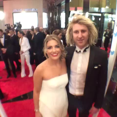 AFL Brownlows post on Vine - Cure couple! Dys repping The Bombers enjoying the #SwisseRedCarpet ahead of the #Brownlow Medal. - AFL Brownlows post on Vine