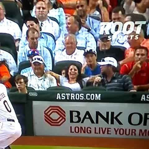 Woman shows boobs behind home plate