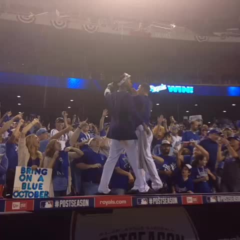 Jarrod Dyson and Johnny Giavotella high five fans on top of dugout as if starts pouring rain. - Jeff Passans post on Vine