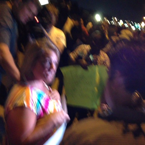 Antonio Frenchs post on Vine - A woman with a sign supporting #DarrenWilson is getting a strong reaction from the crowd. - Antonio Frenchs post on Vine