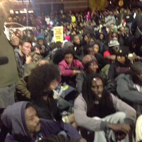 Yamiche Alcindors post on Vine - Quiet crowd outside Ferguson police station. - Yamiche Alcindors post on Vine