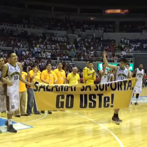 Graduating UST Tigers Aljon Mariano, Kim Lo and Paolo Pe along with courtside reporter Kristelle Batchelor hold up the banner. #UAAP77 - Jane Brachers post on Vine