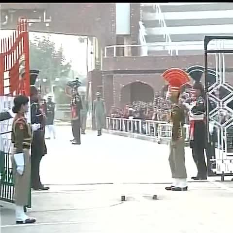 Vine by ANI - BSF Jawans and Pak Rangers shake hands during the Beating Retreat ceremony at Wagah Border #HappyRepublicDay