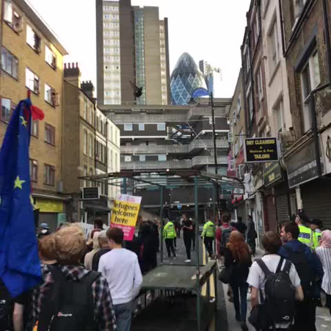 Vine by Harry Fear - 'Tories out! Migrants in!' Pro-migrant rights rally marches to Sky News HQs #London #Brexit