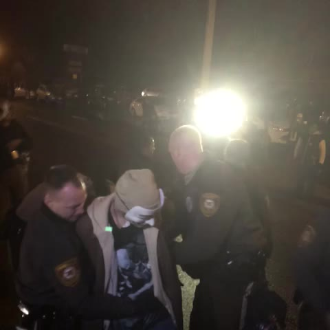 Another arrest in Ferguson. One of the Anonymous masks. Would not give his name - Jon Swaines post on Vine