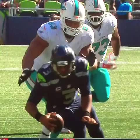 cbb60f4c0 Ndamukong Suh stepped on Russell Wilson s ankle and