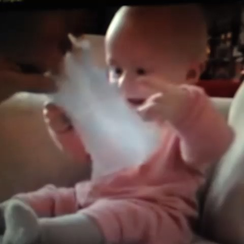 Vine by The Best of YouTube - Baby laughing hysterically at ripping paper.