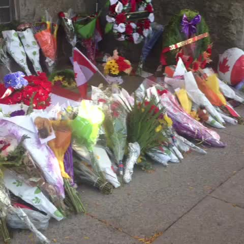 Memorial growing at the Hamilton Armoury in honour of Cpl. Nathan Cirillo. Motorcade arriving in Hamilton b/w 6-7pm. @CityNews - Natalie Duddridges post on Vine