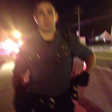 Badge 603. Says we have to get Off the sidewalk. #Ferguson - Nettas post on Vine