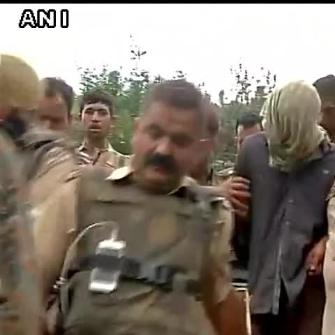 Vine by ANI - Samroli, Udhampur (J&K): The nabbed terrorist being taken by security forces