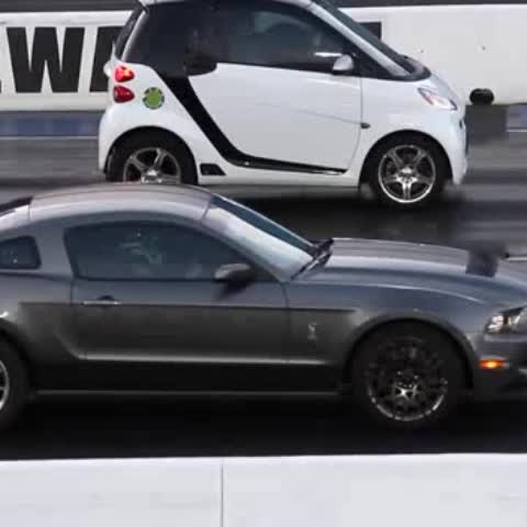 Vine by SuperCarSlam™ - A Smart Car beats a Mustang Shelby Jesus Christ! !!! #SmartCarDoe #omg #wtf #mustangsally #supercarslam #JesusChristKid