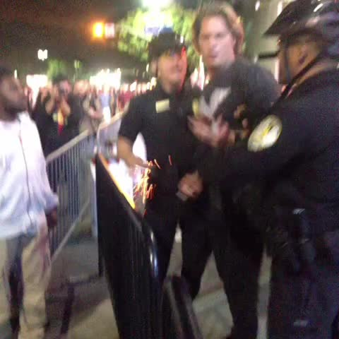 This guy gave a thumbs down and demonstrators didnt like that. #Fergusonverdict #DTLA - Ruben Vivess post on Vine