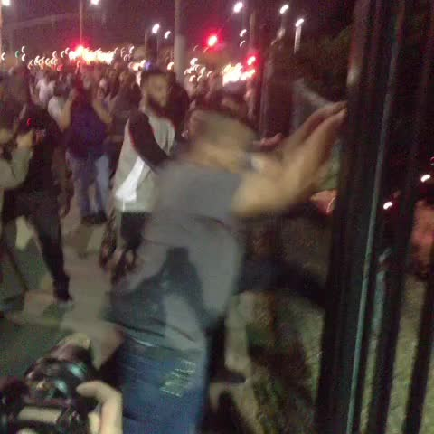 Demonstrators trying to tear down a chain link fence on Figueroa and 23rd street in #DTLA #FergusoVerdict - Ruben Vivess post on Vine