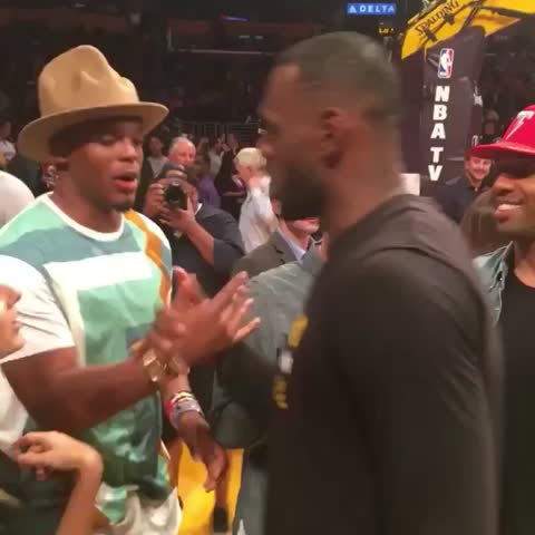 76b0d054412 Check Out Cam Newton Wearing A Pharrell-Style Hat To The Lakers ...