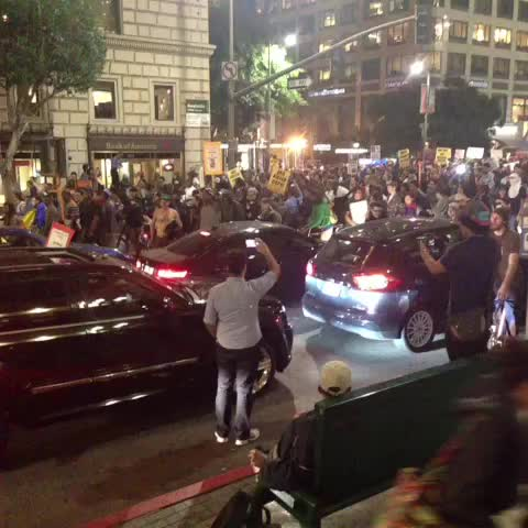 """Demonstrators heading East on 6th Street from Figueroa chanting """"if we dont get no justice, they dont get no peace."""" #Fergusonverdict - Ruben Vivess post on Vine"""