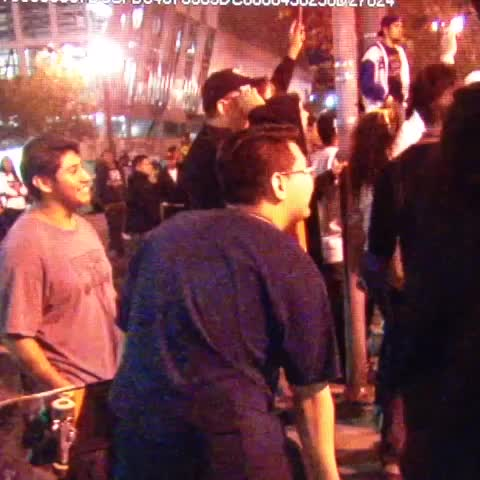 Some #Ferguson protesters are throwing traffic cones & bottles at #LAPD officers guarding police headquarters. - Elex Michaelsons post on Vine
